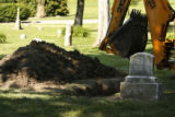 At Oakhill Cemetery a back hoe sit nearby to refill an unmarked grave. In Lawrence, Kansas on...