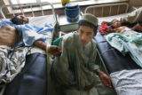 (NYT1) KANDAHAR, Afghanistan -- May 22, 2006 -- AFGHANISTAN-1 -- A man and child injured in an...