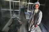 (NYT2) KANDAHAR, Afghanistan -- May 22, 2006 -- AFGHANISTAN-2 -- A man stands inside a morgue at a...
