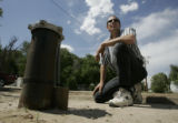 Bernie Pagel kneels by his well that supplies water for the Pagel Trailer Park, Monday May 22,...