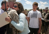 Lcpl. Liam Clarke, cq, left, hugs Jane Rund, cq, Littleton, whose son Lcpl. Gregory Rund was...
