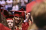 (CENTER) Brittany Daugherty (CQ), 18, of Colorado Springs, arranges the tassel on her cap after...