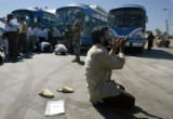 (NYT4) BAGHDAD, Iraq -- June 7, 2006 -- IRAQ-4 -- One of several newly released detainees prays at...