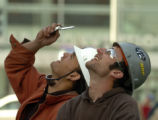 (DENVER, CO., April 14, 2005)  Brandon Archuleta, left, and Bernie Walker, both glaziers on the...