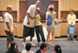 Denver Nugget's Center Marcus Camby, left, hugs Pateah Herdon, right, during an end of the year...