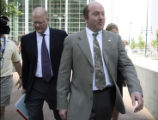 L to R: Defense attorney Will Hood (cq) and Denver firefighter Stan Ford (cq) exit the Denver...