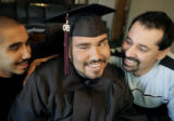 "Pete ""Petey"" Garcia (cq) surrounded by his proud brother, Cruz Garcia (cq) left, and his..."