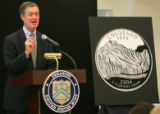 Governor Bill Owens at the ceremonial striking of the first Colorado quarter at the Denver Mint in...