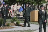 A soldier stands at attention as an approaching soldier begins a salute to the wreath at the new...