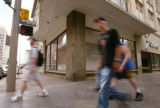 KAS059 Pedestrians walk by the vacant Fontius building on the corner of the 16th Street Mall and...