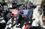 Pallbearers from fire station #9 carries the remain of fellow firefighter Lt Rich Montoya into the...