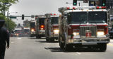 Fire trucks begin the procession down Colfax Ave. in honor of fallen firefighter, Lt Rich...