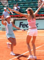 XIN201 - Japan's Ai Sugiyama, left, and Slovakian Daniela Hantuchova, right, cheer after their...