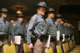 Heather Meredith (cq) ,center, stands at attention with 31 other graduating Colorado State Patrol...