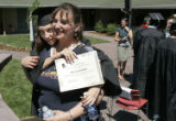 Brandi Rhodes, (cq) 18 of Aurora hugs her mom Denise Shafer (cq) of Wheatridge after getting her...