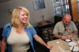 Patty Higginbotham (cq), left, owner of Cafe de France, talks with customer Bill DesRosiers, of...