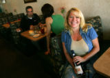 Portrait of Patty Higginbotham (cq), right, owner of Cafe de France in Castle Pines, Colo., on...