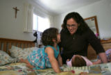 Clare Chavez (cq), of Denver, a member of the Catholic lay organization Opus Dei, and her daughter...