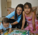 Angie Manzanares (cq), pictured here Sunday May 28, 2006 at her Denver home plays a game of Sorry...
