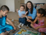 Angie Manzanares (cq), plays a game of Sorry Sunday May 28, 2006 at her Denver home with her three...