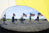 Members of the Colorado Chapter of the Patriot Guard hold American flags at the Colorado Freedom...