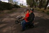 My Dad is a Hero series.  Jessie Martinez, (cq) 11, from Romeo, Colorado, sits on his mini-bike...