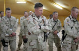 03/30/2005 Camp Udairi-Lt. Colonel Ross Brown, commander of 3ACR's Thunder Squadron, center,...