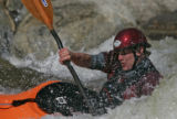 Micah Schnellinger (cq), 19, of Buena Vista, Colo., braves the high water at the Buena Vista River...
