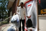 Ahmed Falama, cq, is handed some of his personal belongings through a makeshift sealed doorway at...