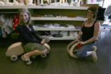 Becky Clawson, left, no glasses, smiling, with Cassandra Cech, (cq both), together ride store sale...