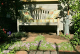 A sunny bench add to Erika Schafer's new look in her back yard in Denver, Colo. on 5/25/06. A...