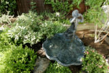 A fountain adds to Erika Schafer's new look in her back yard in Denver, Colo. on 5/25/06. A...