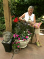 Erika Schafer relaxes in a shady area. She has a new look in her back yard in Denver, Colo. on...