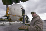(DENVER, Colo., March 31, 2005) Jerry Gray (cq), right, of Lockheed Martin, watches as employees...