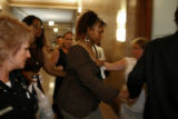 Pamela Richardson is lead in to a room as he leaves a courtroom Wednesday June 14, 2006 after her...