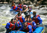 Whitewater rafters from Buffalo Joe's negotiate the Zoom-Flume rapids another group follows close...