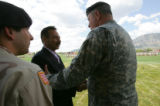 The Mayor of Tel Afar Najim Abdullah (cq) shakes hands with Major General James Simmons at a...