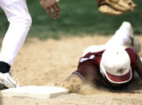 Safe by a fingertip, Cherokee's #34, Mike Carrasco, slides by and under, Broomfield's first...