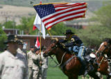 Members of the 3rd ACR cavalry do a charge at a ceremony at Fort Carson by the 3rd ACR in Colorado...