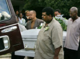 Aaron Thompson, center,  leads the pallbearers in carrying the casket of Shely Lowe out of Mount...