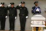 Denver Police Officers salute as Technical Sgt. Ken Jones, right, of the Mile High Honor Guard,...