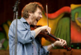 Sam Bush plays the fiddle as he sits in with the Drew Emmitt Band on opening day of the 33rd...