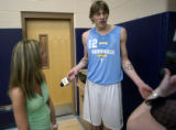 Denver, Colo., April 26, 2004- Nuggets rookie, Chris Anderson, grabs the microphone away from a...