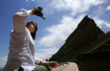 Robin Gerstenfeld (cq), of Portland, OR., takes pictures at Red Rocks Amphitheater and Park, near...