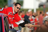 NCKD102 - Carolina Hurricanes' Craig Adams is congratulated by a fan, Tuesday, June 20, 2006,...