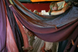 Lizzy Swenson (cq) (r) along with friend Jessica Hirmer (cq) (l) hang drapery in the Mahamudra...