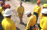 Gov. Bill Owens  talks to ground crew members fighting the fire just  north of  Hwy. 160  a few...