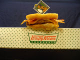 Hamburger, complete with Krispy Kreme donuts as a bun, wich cheddar cheese and bacon. The delicacy...