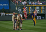 Members of Cub Scout Pack #467 of Centennial, CO, stand in Coors Field, Monday night, June 5,...