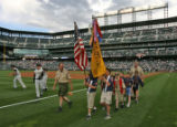 Members of Cub Scout Pack #467 of Centennial, CO, leave Coors Field, Monday night, June 5, 2006,...
